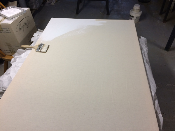 stretched canvas, with primer coating one corner