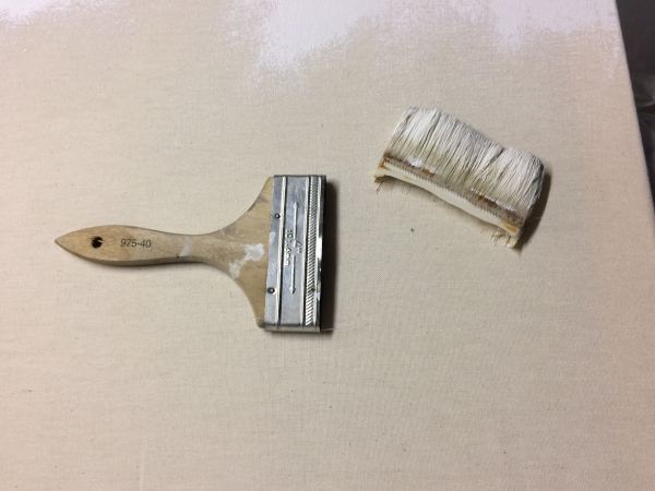 a paint brush with the block of bristles removed